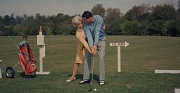 Teaches him golf