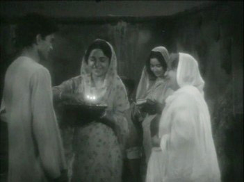 A young man is sent off by his womenfolk