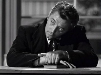 Mitchum as Harry Powell in The Night of the Hunter