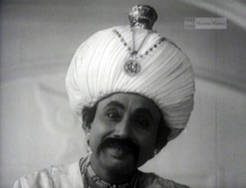 The Raja of Shundi tells Goopy and Bagha about his brother