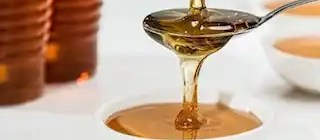 Honey Flowing From a spoon, flow hive review