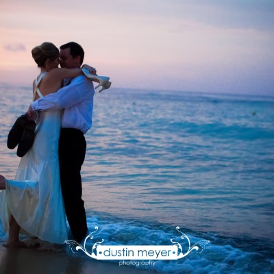 A bride and groom dance on the beach after their destination wedding photography in Ocho Rios, Jamaica.