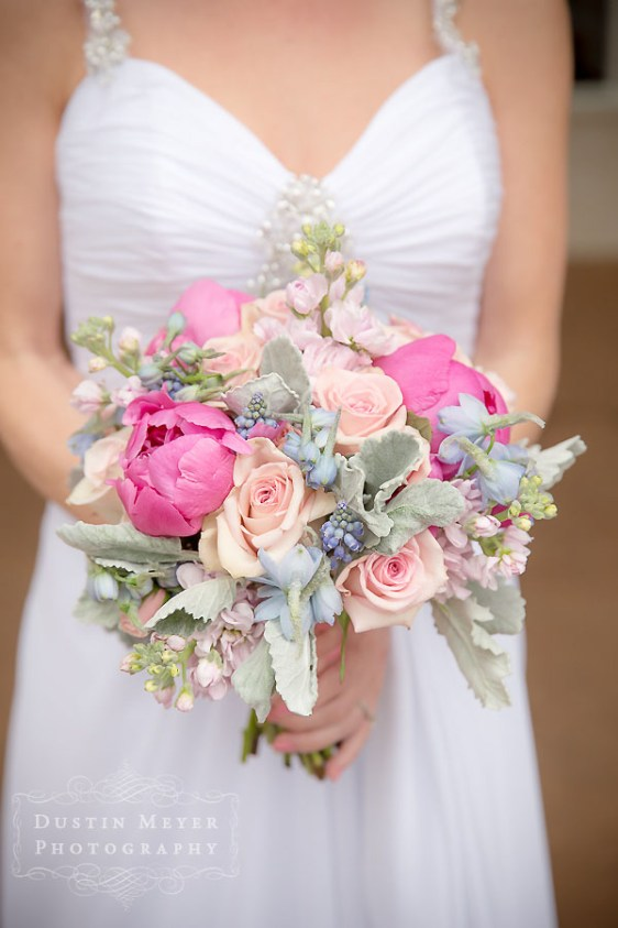 A stunning and unique bridal bouquet with pink, green, and fuchsia colors elegantly created by Austin wedding and bridal florist Verbena Floral Design