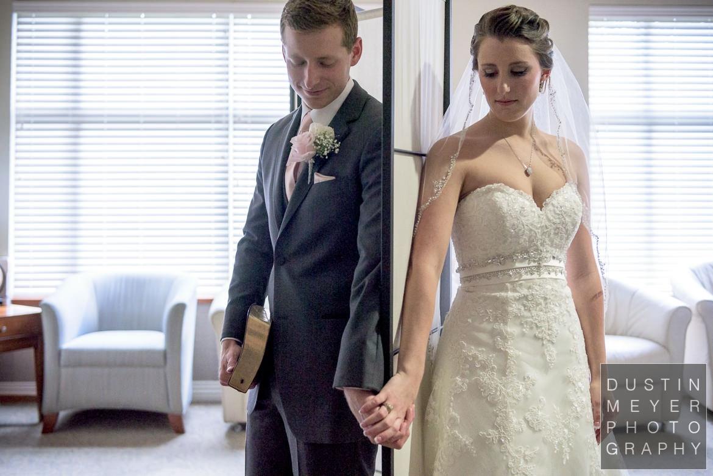 bride and groom praying before wedding ceremony