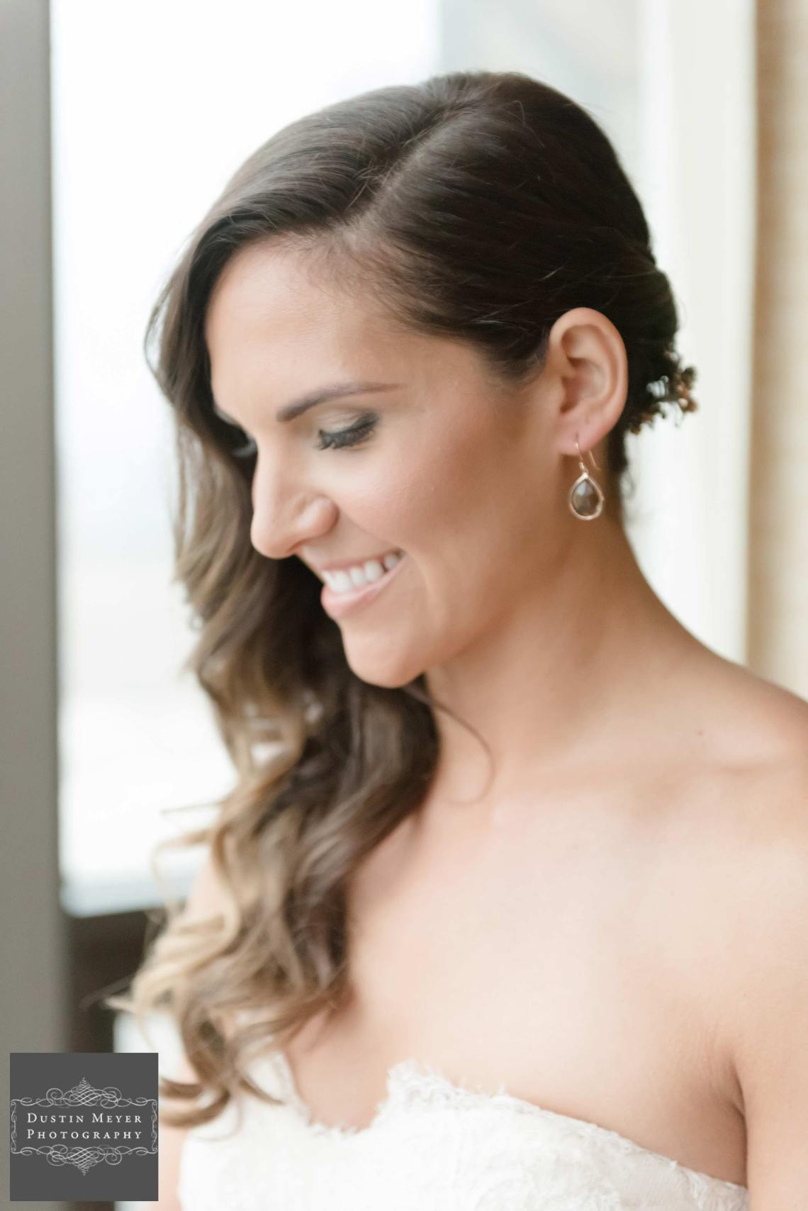 brunette bride natural light wearing a strapless bridal gown, earrings, jewelry, with a smile, austin wedding photographer