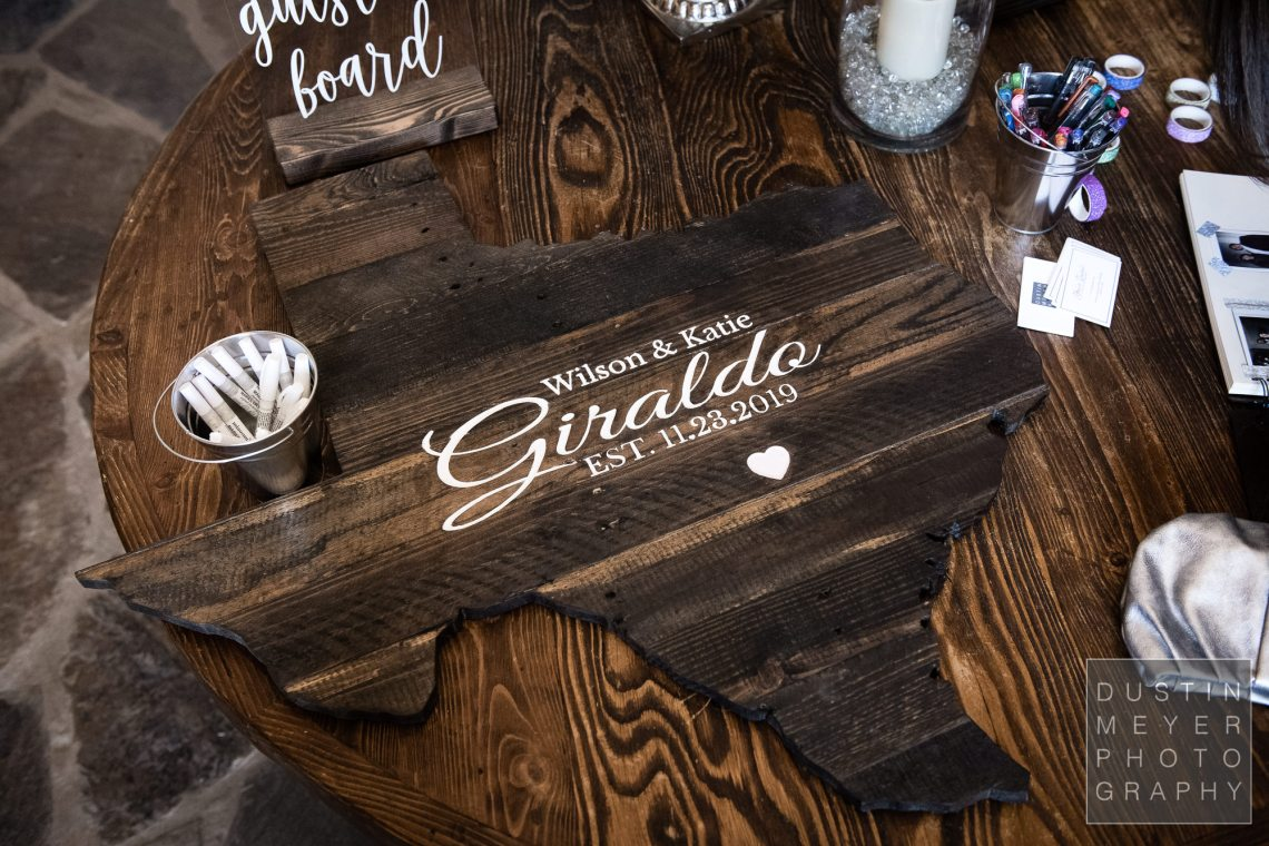 """A custom personalized wedding sign-in """"album"""" made of hill country natural wood."""