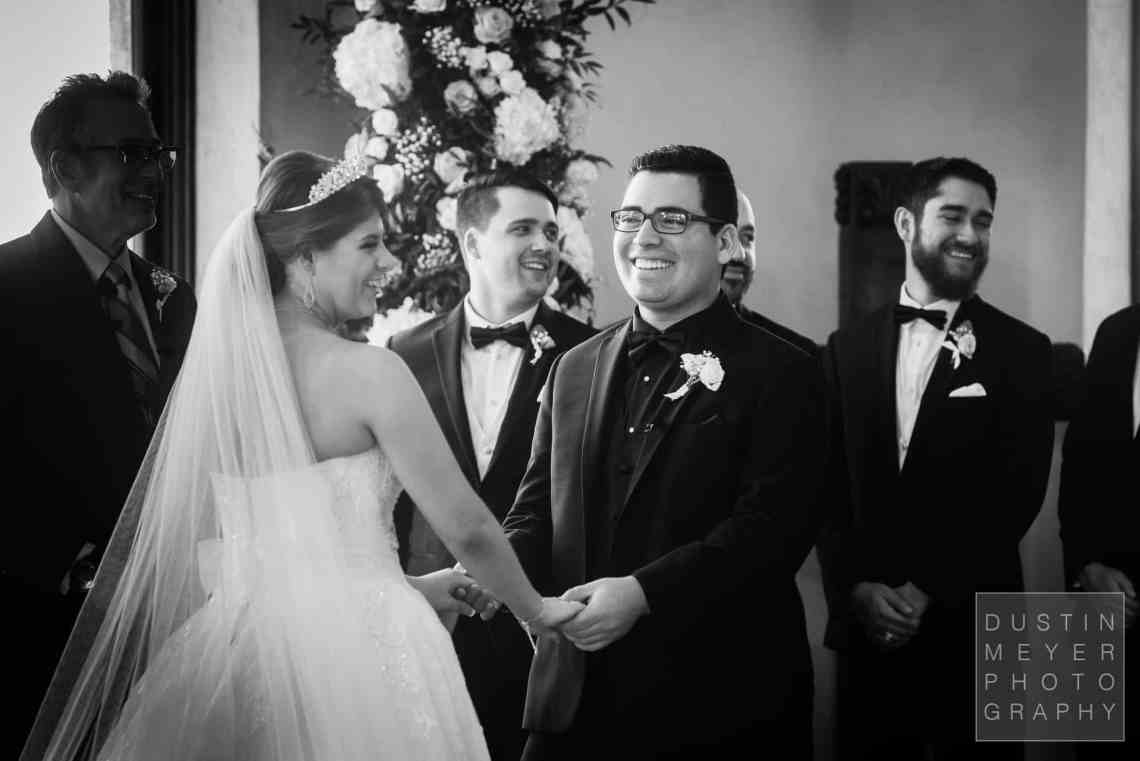 A candid photojournalism picture of the wedding bride and groom excited about their marriage.