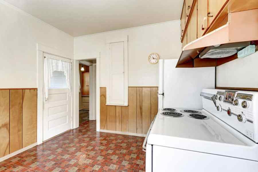 Interior of old style kitchen with linoleum floor