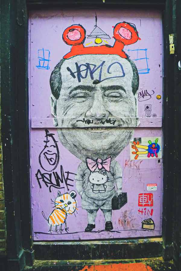 Shoreditch paste-up by HIN of Berlusconi wearing a Hello Kitty shirt and bunny ears