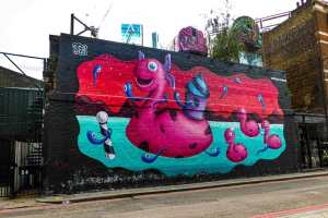 street art by SER on music venue Village Underground in Shoreditch, London of giant-size bath tub toys