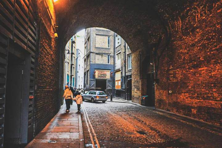 dark scary looking tunnel near London Bridge with Clink Prison Museum at the end