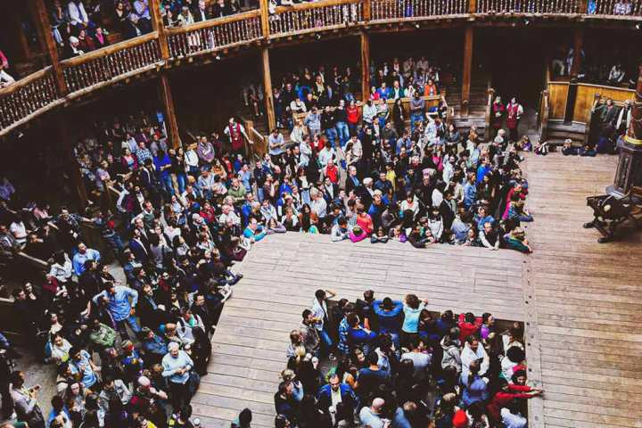 interior shot of Globe Theatre, London, looking down at the audience on ground level