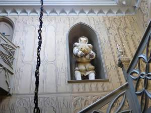 Art installation by Laura Ford of white teddy bear in the staircase of Strawberry Hill House