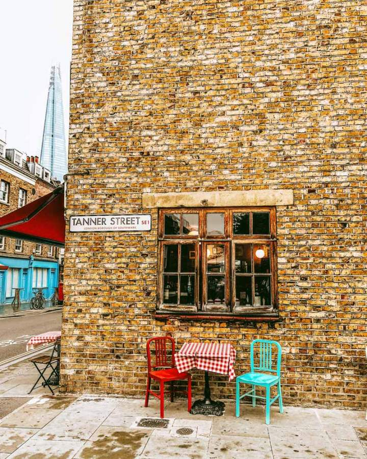 Picturesque street view in Bermondsey, London, of a cute corner with The Shard skyscraper in the background