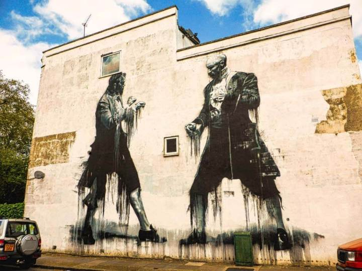 Conor Harrington street art mural in Dulwich, London, of two men about to fight and dressed in 17th-century clothing