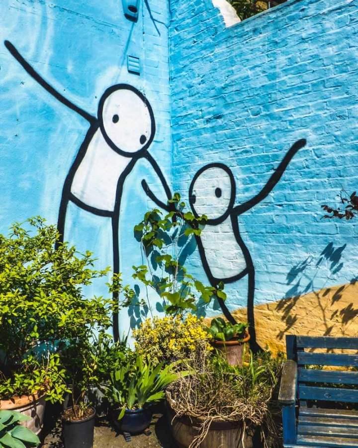 Street art mural by Stik in Dulwich, London, based on 'The Guardian Angel' by Marcantonio Franceschini