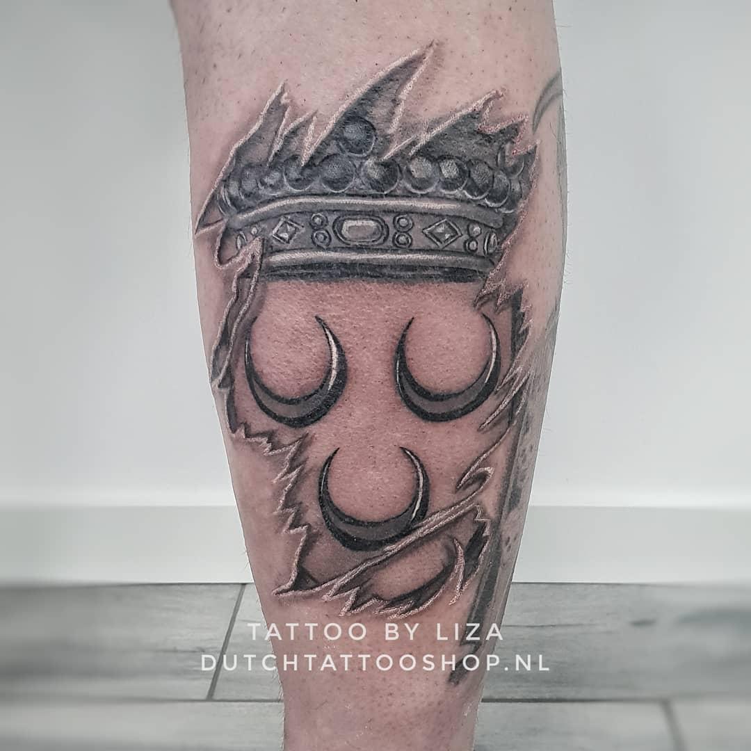 wapen-van-voorschoten-tattoo-gescheurde-huid