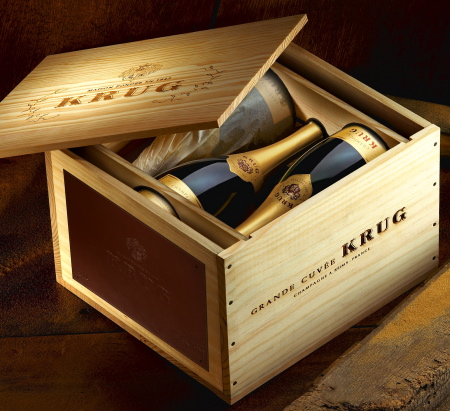 """As the ultimate holiday gift for champagne connoisseurs, the famed French House of Krug is offering a bespoke cellar case containing six bottles of Krug's prestigious Grand Cuvée. Called Krug 'On My Own Terms', the luxe case can be ordered with a personalized plaque in either metal, mirror, or saddle leather bearing the Champagne Krug coat of arms and the recipient's name or initials. The case costs $1,000. Krug, founded in 1843, is now part of the LVMH empire. The Grand Cuvée is described as """"the timelessly stylish signature of Krug."""" The cellar case is the latest in a line of luxurious Krug offerings, including the Escape Artist trunks and Hat Box."""