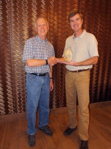 EPA Team Leader Bill Adams, presents DU Biologist Chris Bonsignore with the Howard Orlean Excellence in Site Reuse Award