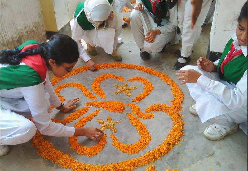 092015 Bangladesh flowers WAGGGS logo