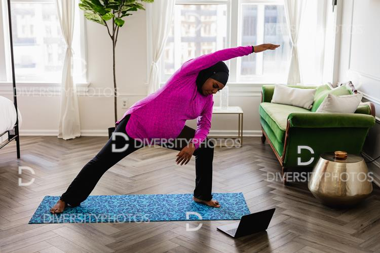 Almost all types of yoga share the same foundation of poses, but there are differences. Black Muslim Woman Does Yoga At Home Wearing A Sport Hijab Watching Online Tutorial Instructional Video Diversity Photos Premium Stock Photos