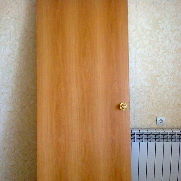 Дверное полотно покрытое ламинатином