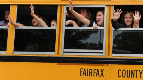 CLIFTON, VA - JUNE 21: Students aboard a school bus wave bye to their teachers at the end of classes during the last day of school at Clifton Elementary School on June 21, 2011 in Clifton, Va. The school is permanently closing its doors because of county boundary changes. Clifton is one of the most rural areas in Fairfax County bringing in kids from one tenth of the county's size. The closing of the school is so controversial that the decision is the subject of a lawsuit in front of the state Supreme Court.