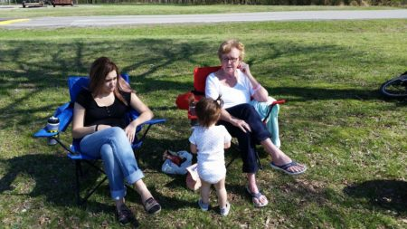 Grandma, Jamie and Maddie watching the kickball game.