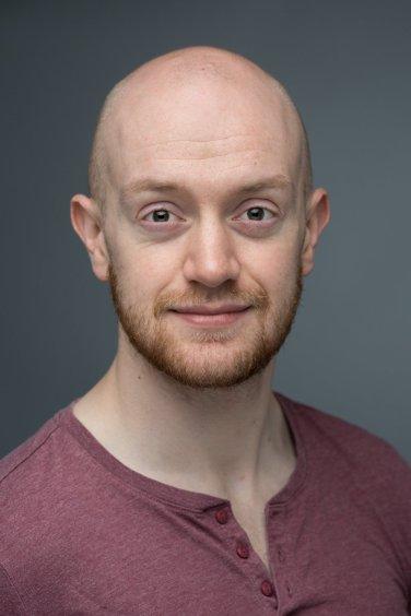 Headshot of actor Jonny McClean in Leicester studio