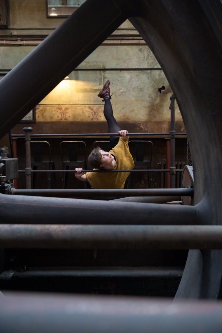 View of Aimee Lily Williamson dancing through a mill wheel