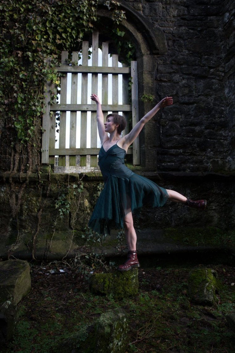 Aimee Lily Williamson pirouetting on a rock