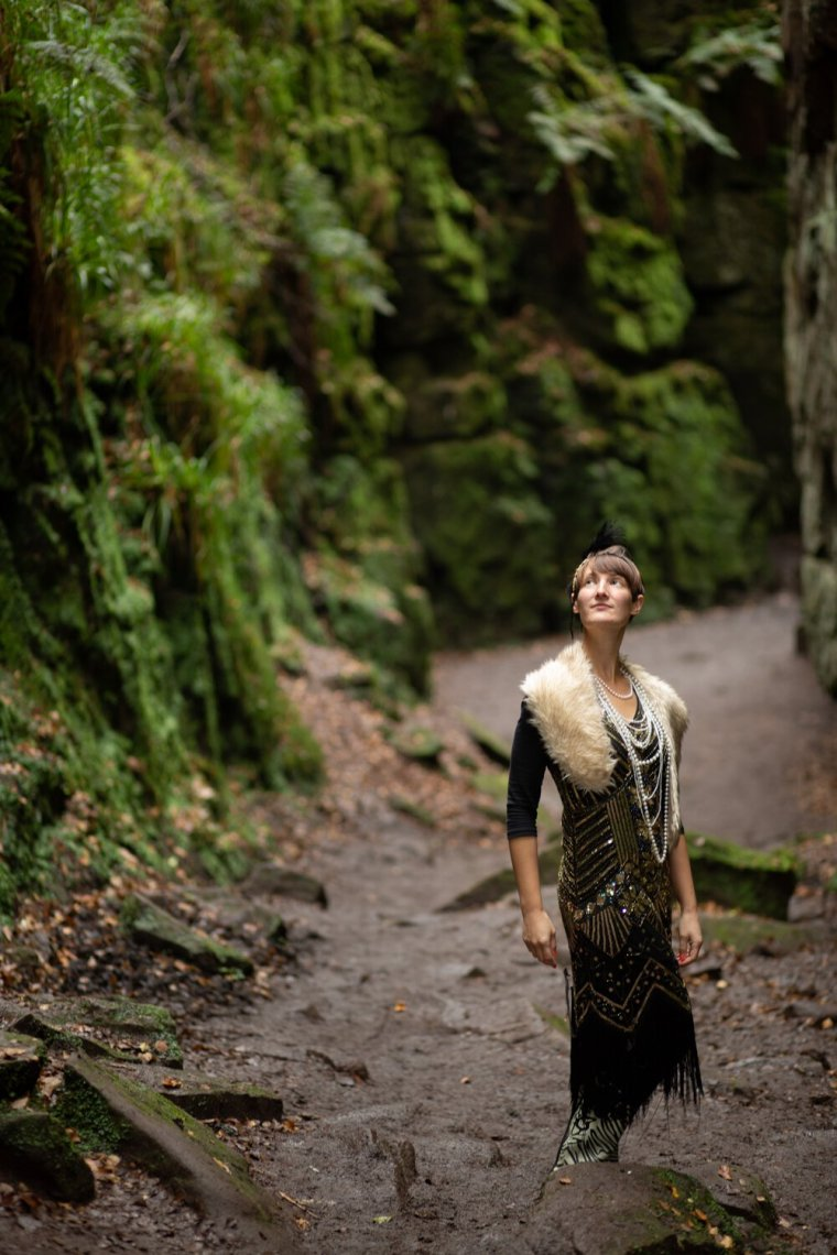 IsoElegant wearing a flapper dress, in the long chasm of Lud's Church.