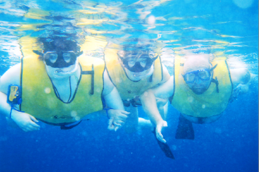 This is us IN the sea - well sort of; we had trouble staying under the water for the shot! :-)