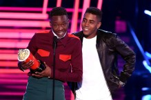 LOS ANGELES, CA - MAY 07: Actors Ashton Sanders (L) and Jharrel Jerome accept Best Kiss for 'Moonlight' onstage during the 2017 MTV Movie And TV Awards at The Shrine Auditorium on May 7, 2017 in Los Angeles, California. (Photo by Kevin Winter/Getty Images)