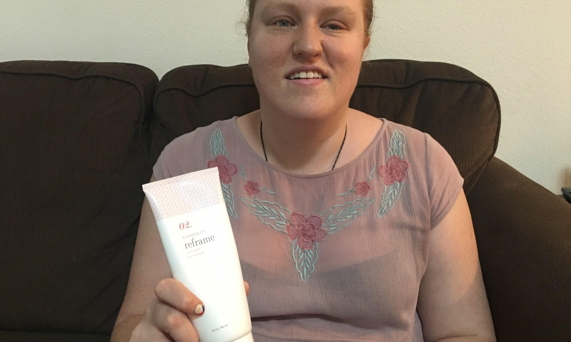 Katie Corbett holds Jamberry Hair product.