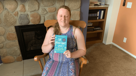 "Katie Corbett holds the book ""The Renaissance Soul"""