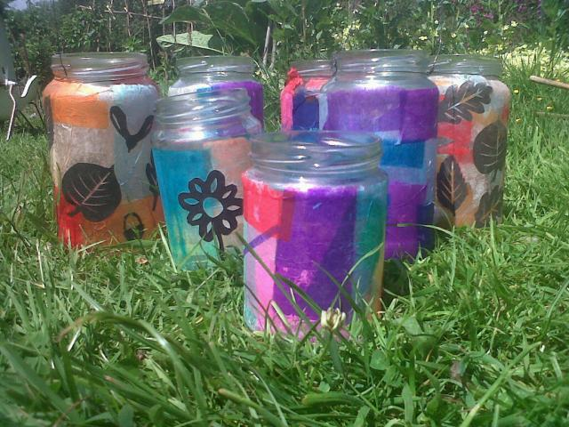 Some of the candle lanterns we made, from jars decorated with tissue paper and black paper cut-outs