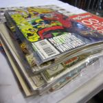Lot Of Comics Spiderman And Others Coins And Rolling Stones Coffee Table Book