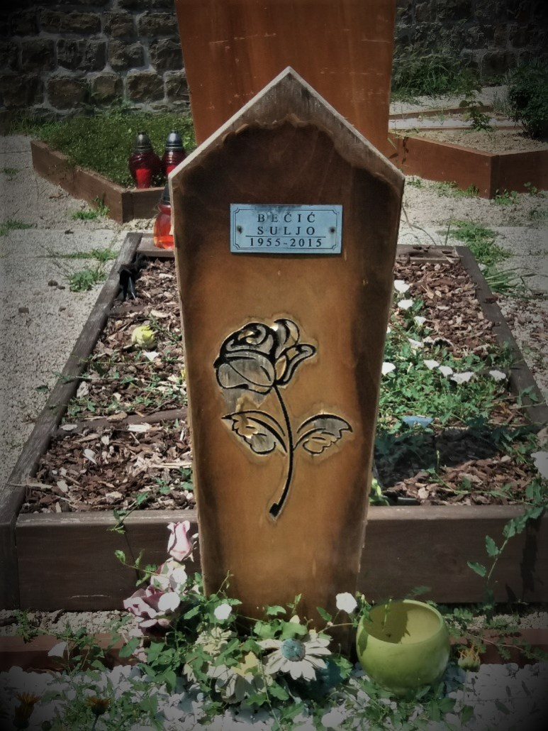 Carved wooden gravemarker at Pokopališče Piran Cemetery