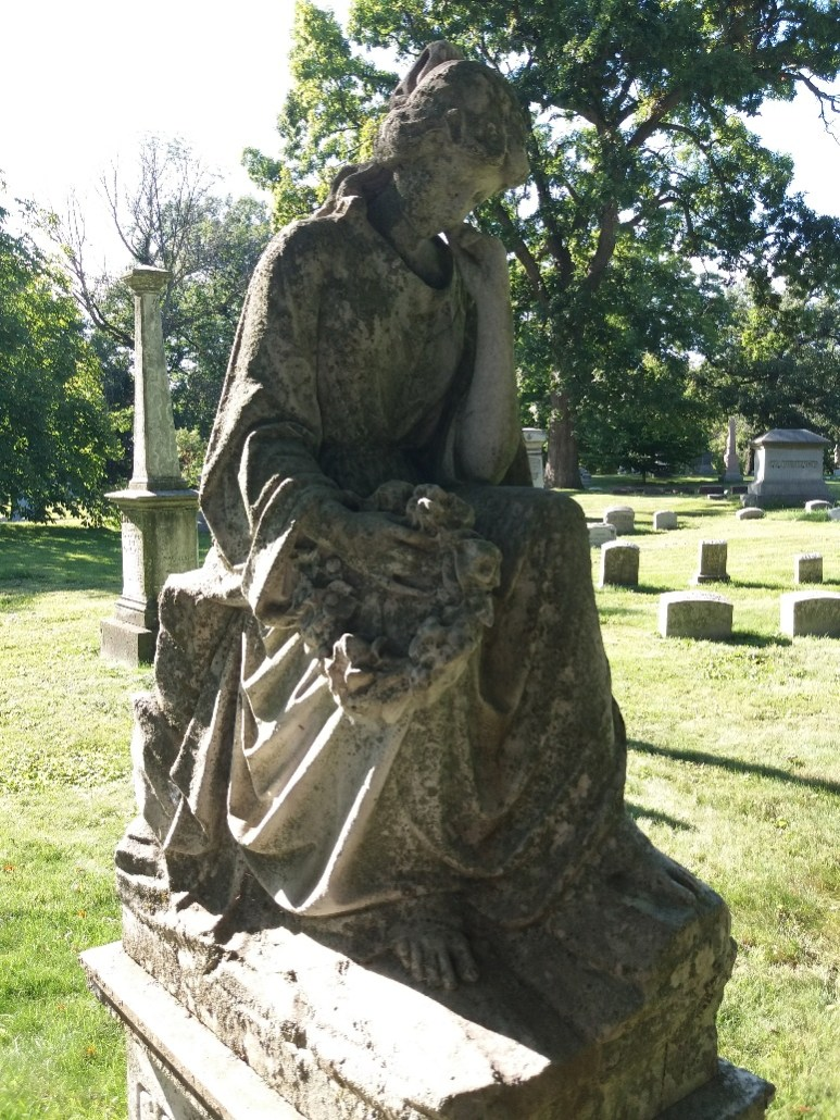 Grieving woman headstone in Forest Home Cemetery, Milwaukee WI
