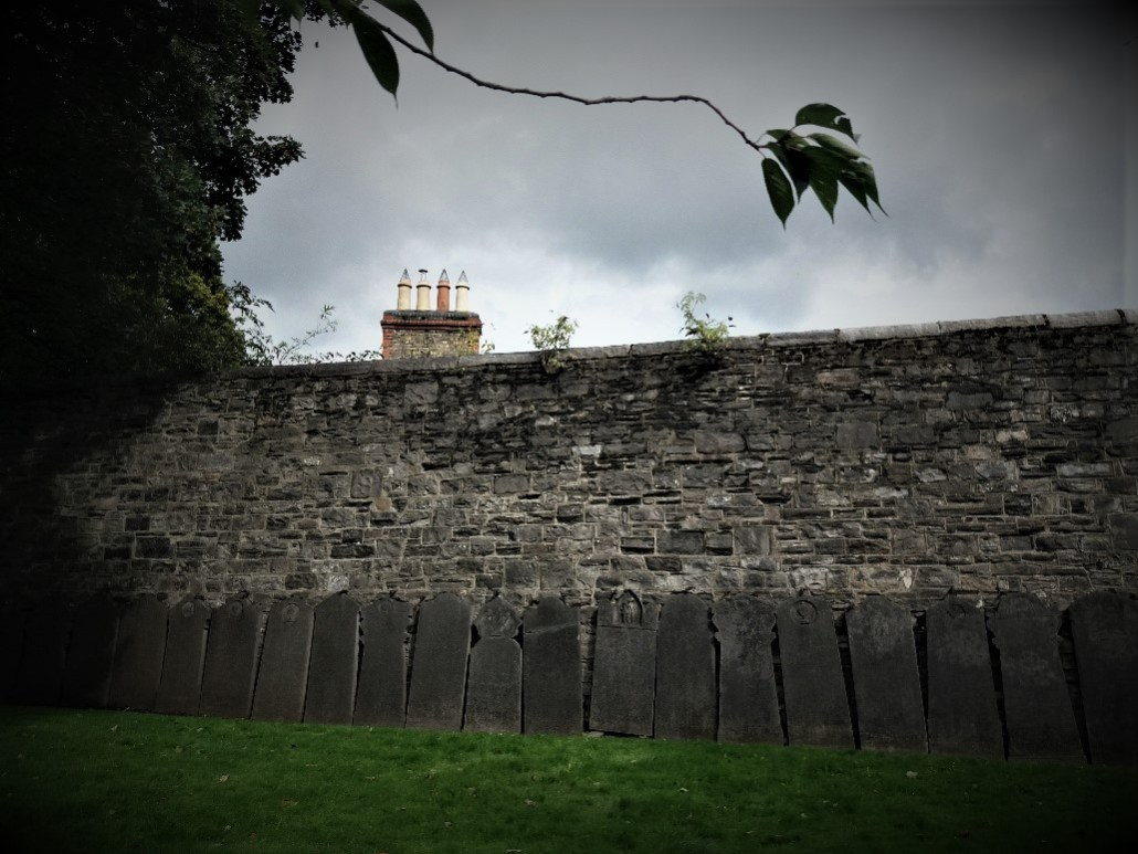 Headstones lined up against the walls of Arbour Hill Cemetery Dublin