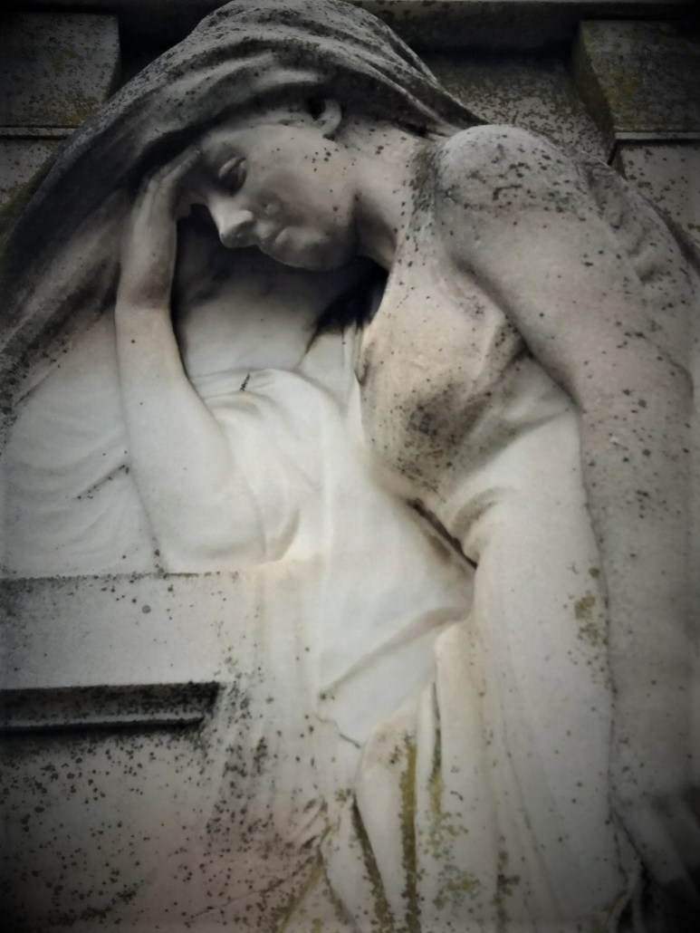 close-up of Grieving mother Luiszer family tomb Sümeg Cemetery Hungary