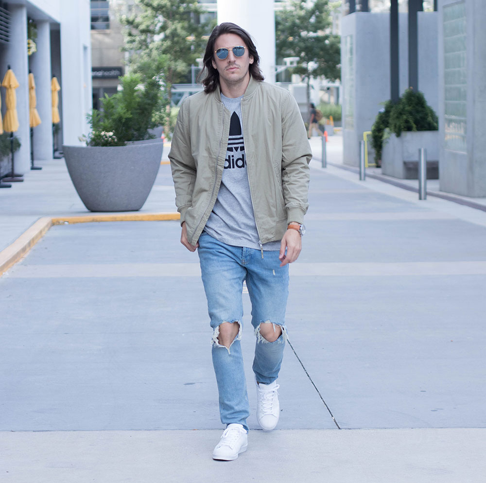 Olive Bomber Jacket and Distressed Jeans