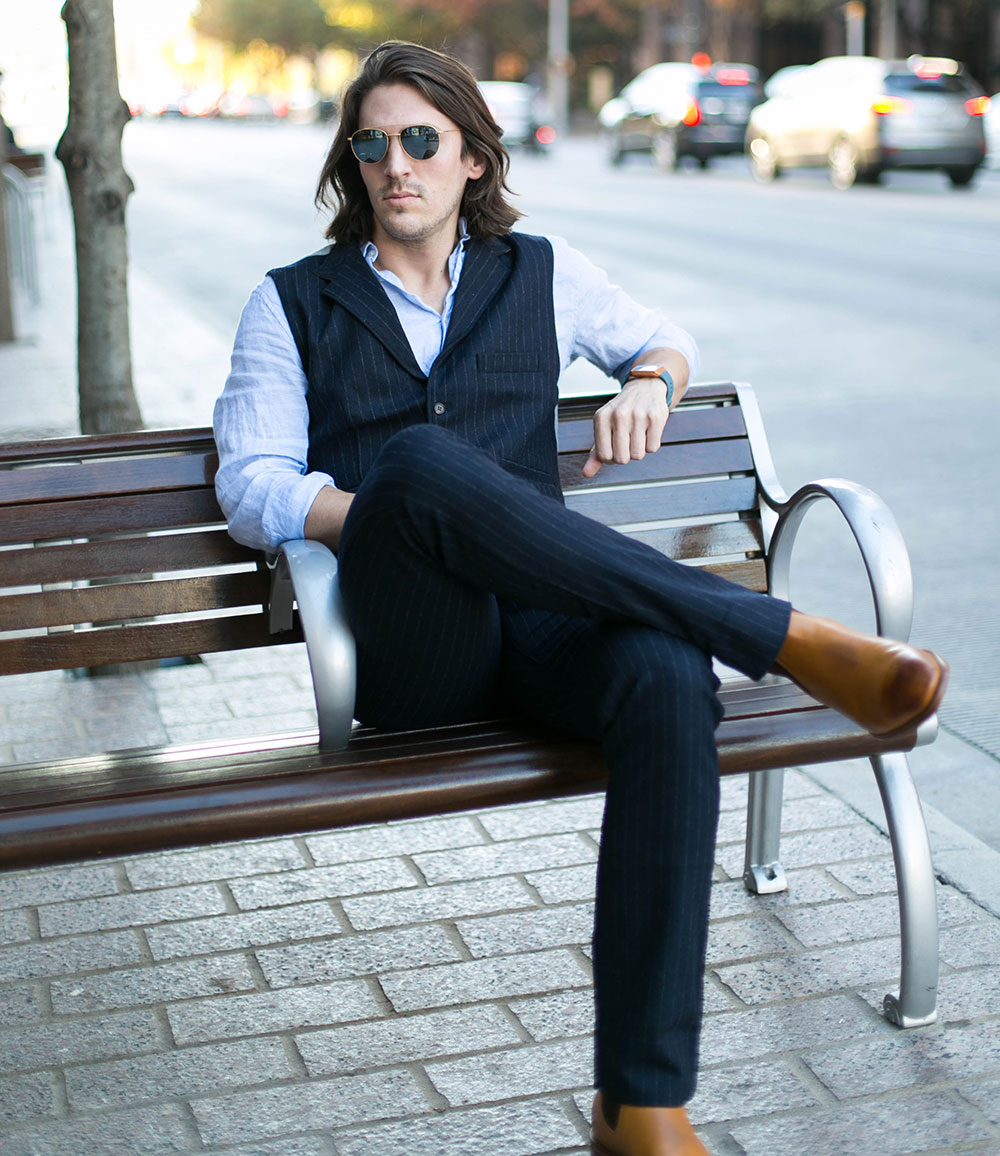 Shop Sitting in Nifty Genius Navy Striped Vest and Pants with Linen Shirt and R. M. Williams Burnished Toe Chelsea Boots