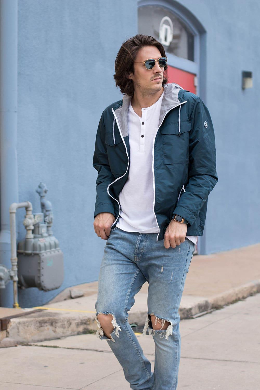 Distressed Jeans, White Henley, Blue Rain Jacket