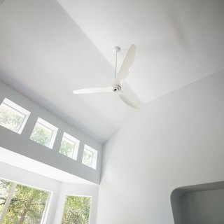 """Haiku 84"""" White Aluminum Ceiling Fan in Living Room"""