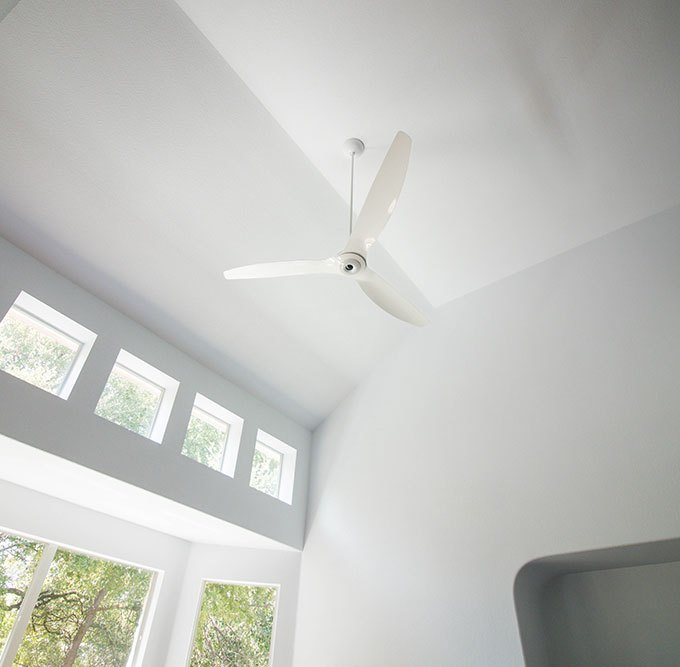 "Haiku 84"" White Aluminum Ceiling Fan in Living Room"