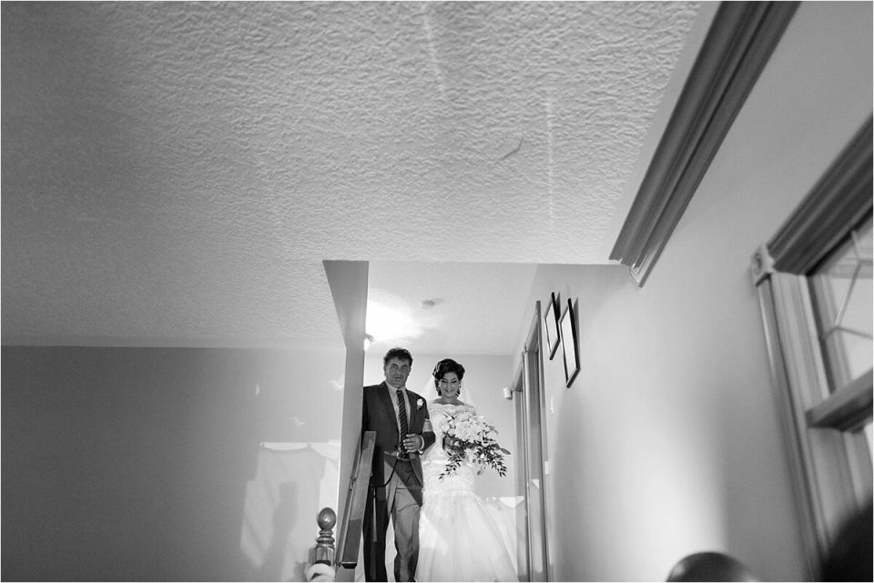 Bride walking with father towards groom - Woodstock London Ontario Lebanese middle eastern arab Wedding and engagement photos - Dylan Martin Photography
