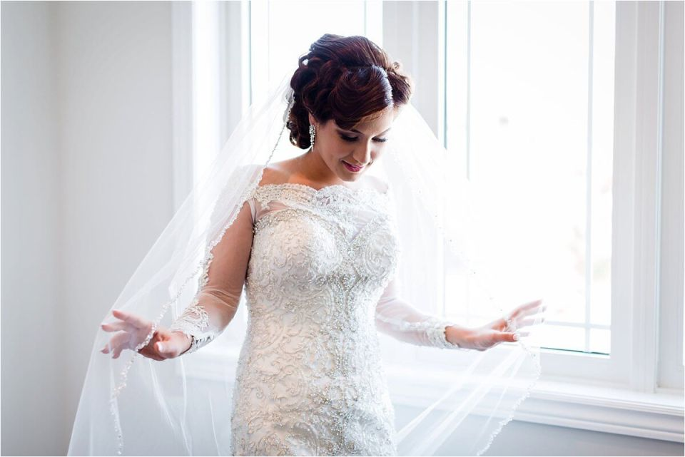 Beautiful bride in lace wedding dress in front of window - Woodstock London Ontario Lebanese middle eastern arab Wedding and engagement photos - Dylan Martin Photography