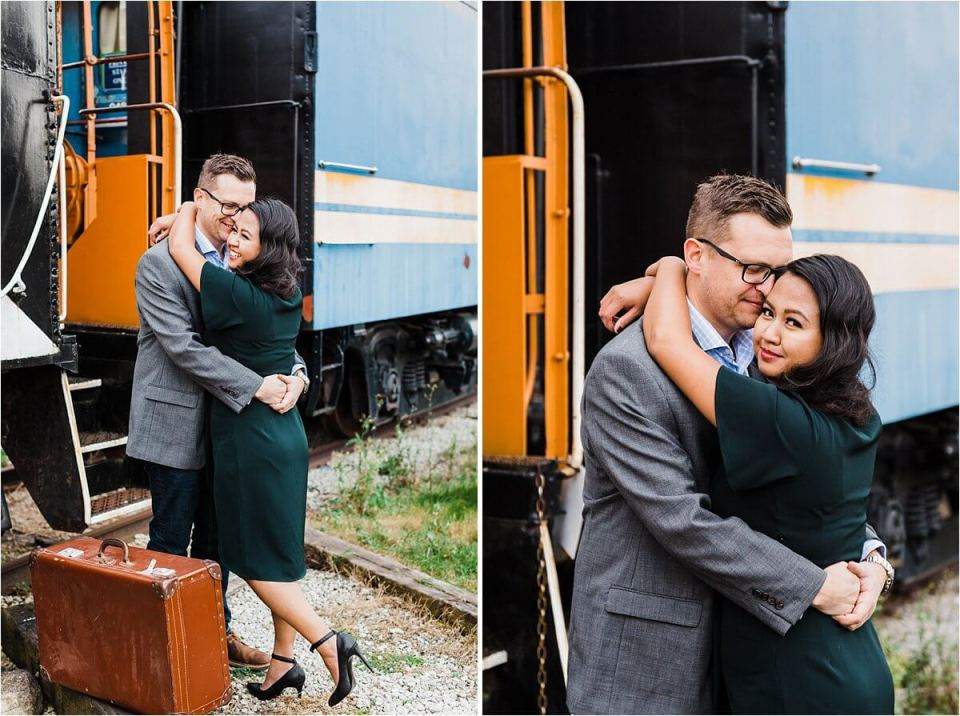 Engaged couple with vintage suitcase at train station - London Cambridge Stratford Woodstock Grand Bend Strathroy Ontario Wedding Engagement Photographer by Dylan Martin Photography with Dylan and Sandra